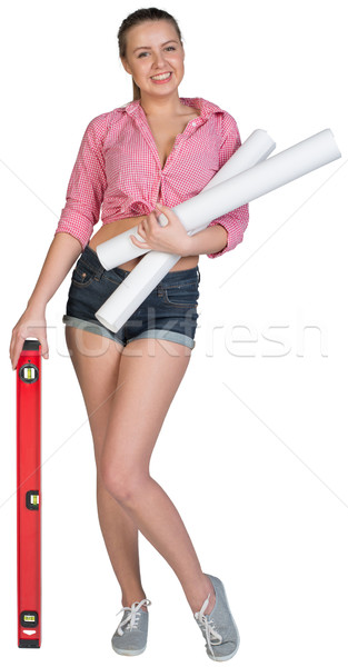 Woman holding drawing rolls and builders level Stock photo © cherezoff