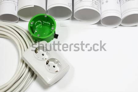 Architectural drawings scrolls with electrical cable, LED bulb and enclosures Stock photo © cherezoff