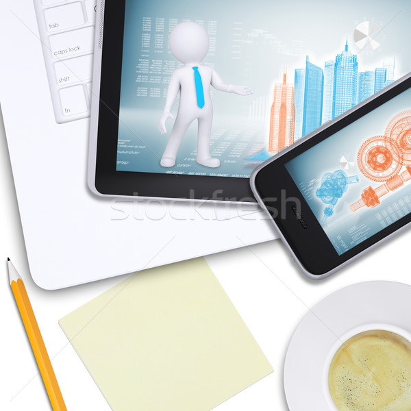 Tablet and mobile on laptop with note paper Stock photo © cherezoff