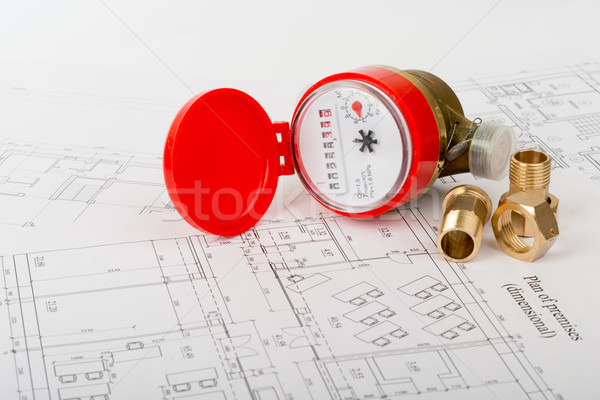Red water meter with fitting pieces  Stock photo © cherezoff
