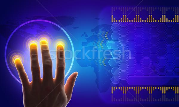 Kéz megérint holografikus képernyő világtérkép Stock fotó © cherezoff