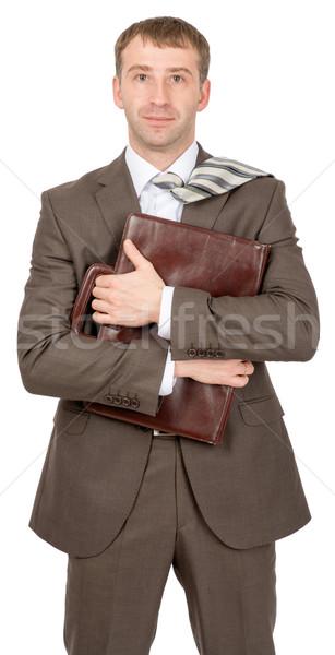 Businessman hugging suitcase Stock photo © cherezoff
