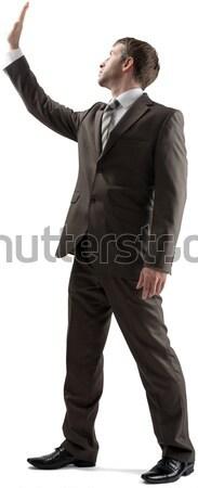 Businessman protecting himself  Stock photo © cherezoff