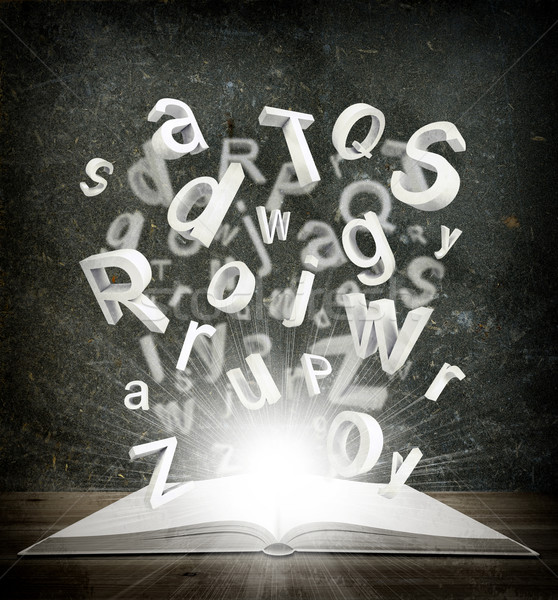 Letters are emitted from an open book Stock photo © cherezoff