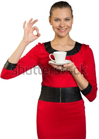 Young smiling woman holding tea cup Stock photo © cherezoff