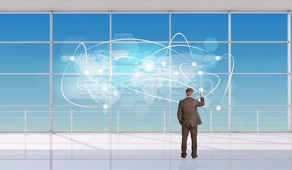 üzletember megérint holografikus képernyő ablak hátulnézet Stock fotó © cherezoff
