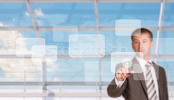 üzletember kisajtolás holografikus képernyő ablak világtérkép Stock fotó © cherezoff
