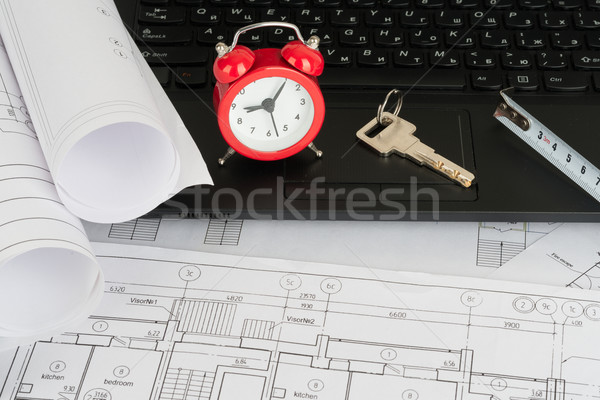 Laptop with drafts and alarm clock Stock photo © cherezoff