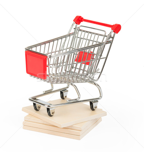 Shopping cart on paving tiles, side view Stock photo © cherezoff