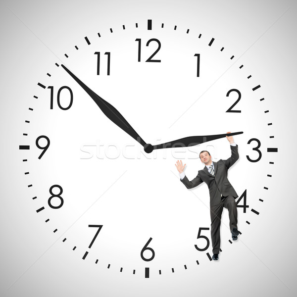 üzletember toló óramutató bent óra izolált Stock fotó © cherezoff