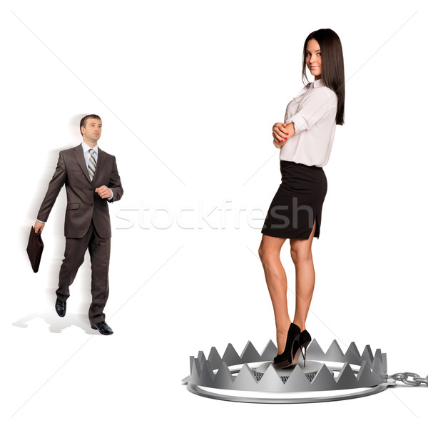 Businessman with woman in bear trap Stock photo © cherezoff