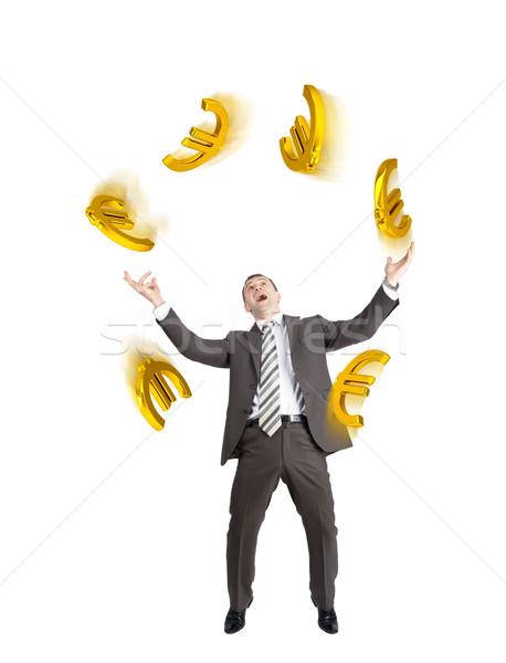 Businessman juggling euro signs Stock photo © cherezoff