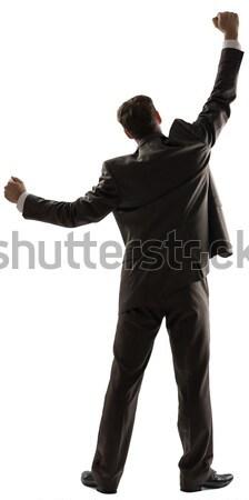 вид сзади успешный деловой человек оружия вверх изолированный Сток-фото © cherezoff