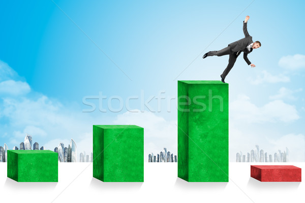 Businessmen falling down toward economic crisis Stock photo © cherezoff