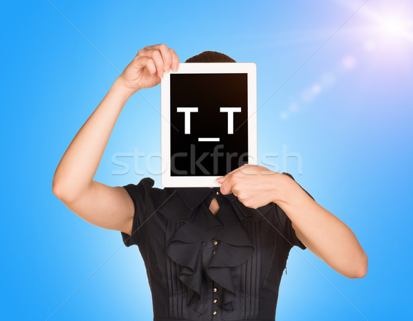 Young girl in dress covered her face with tablet. On screen code smiley Stock photo © cherezoff