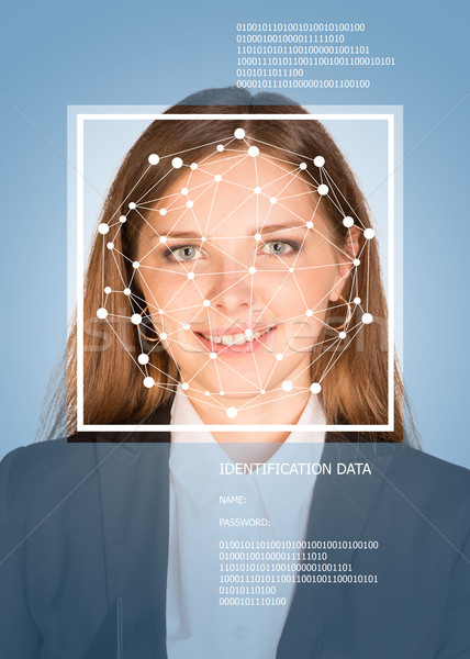 Concept of person identification. Girl face with lines and text Stock photo © cherezoff