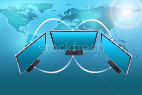 Set of monitors with world map and lightspot Stock photo © cherezoff