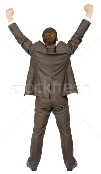 Businessman standing in winnig posture, rear view Stock photo © cherezoff