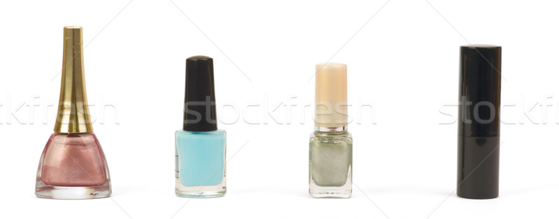 Bottles with nail polish and lipstick over white Stock photo © cherezoff