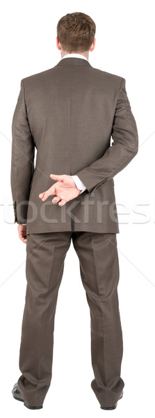 Businessman with his fingers crossed Stock photo © cherezoff
