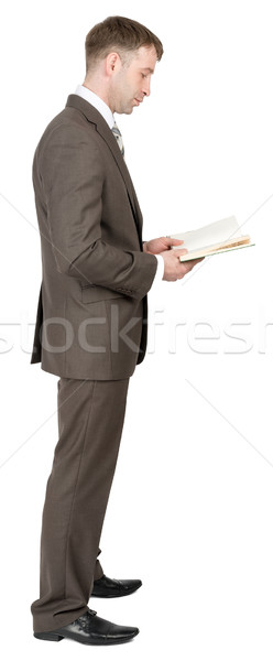 Businessman reading book Stock photo © cherezoff