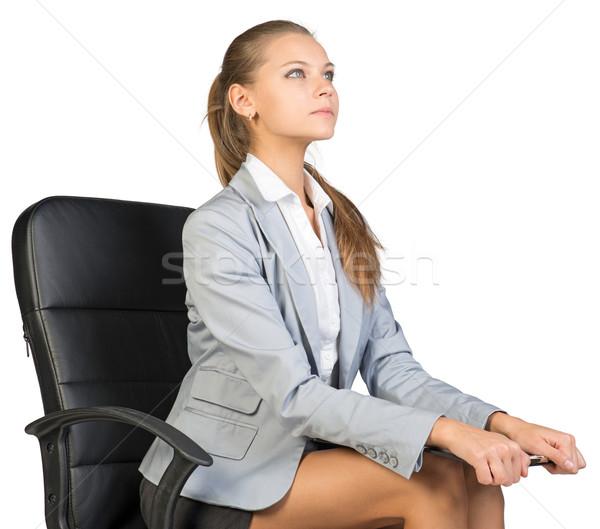 Işkadını oturma ofis koltuğu bakıyor Stok fotoğraf © cherezoff