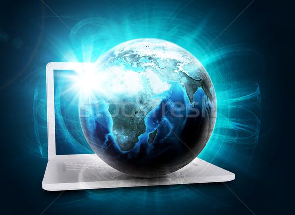 Earth model in haze on laptop Stock photo © cherezoff