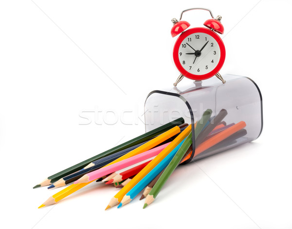 Fallen pencil cup with crayons and alarm clock Stock photo © cherezoff
