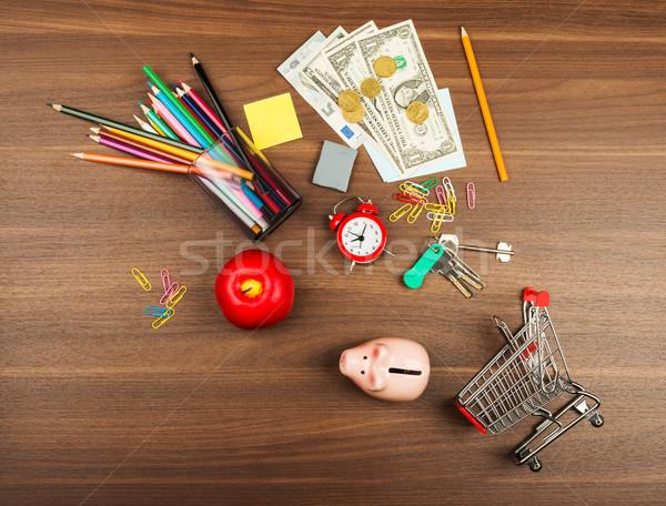 Bevásárlókocsi irodaszerek pénz fa asztal fa ceruza Stock fotó © cherezoff