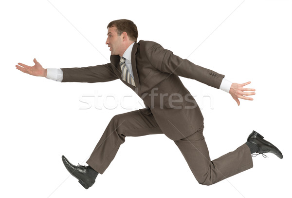 Businessman running fast with empty hand  Stock photo © cherezoff