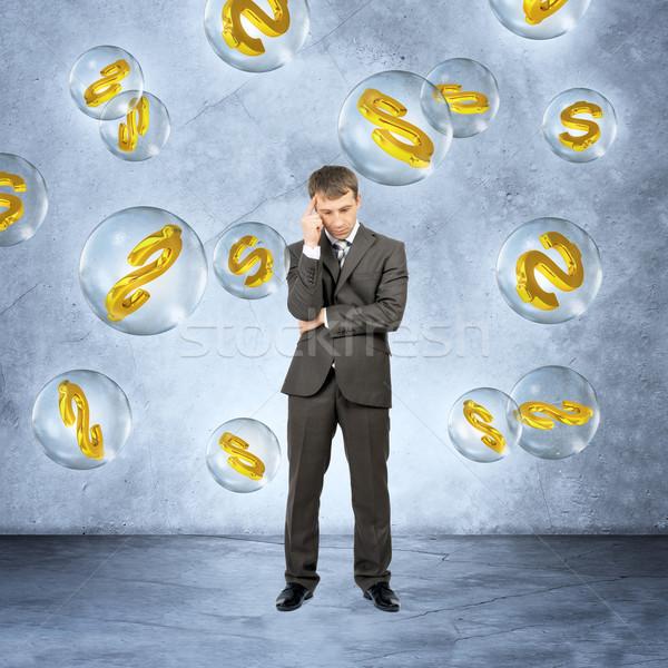 Thinking businessman under money rain Stock photo © cherezoff