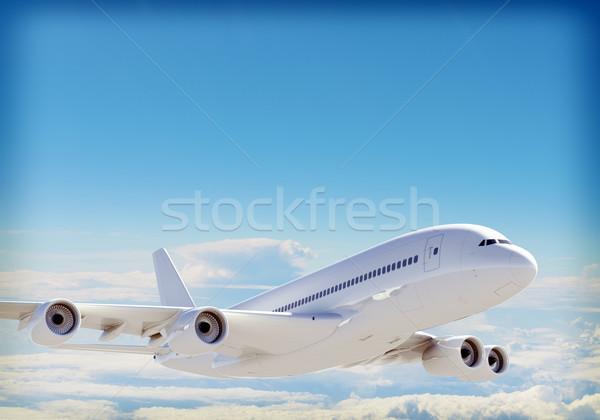Passenger jet plane flies above the clouds Stock photo © cherezoff