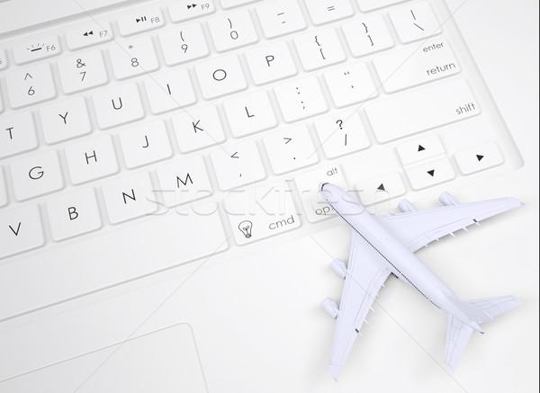 Airplane on the keyboard Stock photo © cherezoff