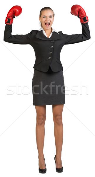 Kobieta interesu rękawice bokserskie stałego zwycięstwo stanowią Zdjęcia stock © cherezoff