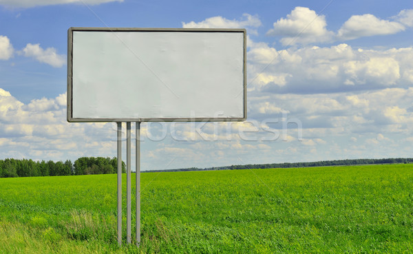 Billboard on nature background Stock photo © cherezoff