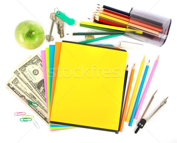 Copybooks with dollars and office stuff Stock photo © cherezoff
