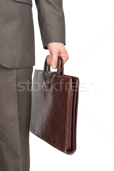 Businessman with leather suitcase, front view Stock photo © cherezoff