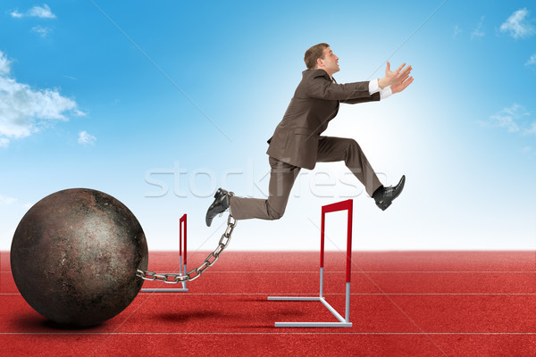 Businessman jumping over barrier Stock photo © cherezoff