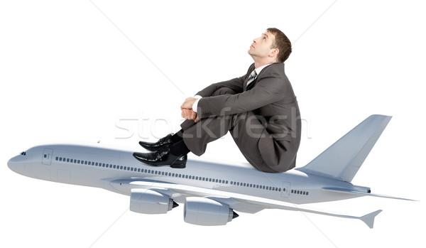 Imprenditore seduta jet isolato bianco suit Foto d'archivio © cherezoff