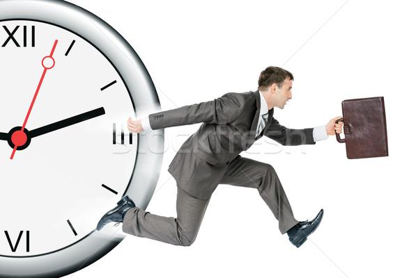 Businessman runaway from clock Stock photo © cherezoff