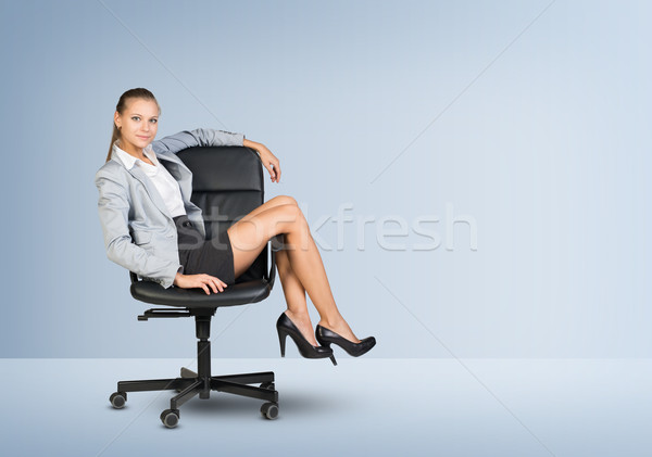 Businesswoman sitting on office chair Stock photo © cherezoff