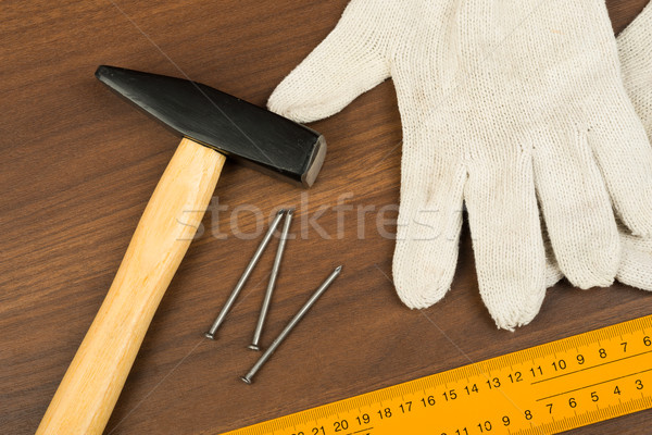 Hammer, protective gloves and three nails Stock photo © cherezoff