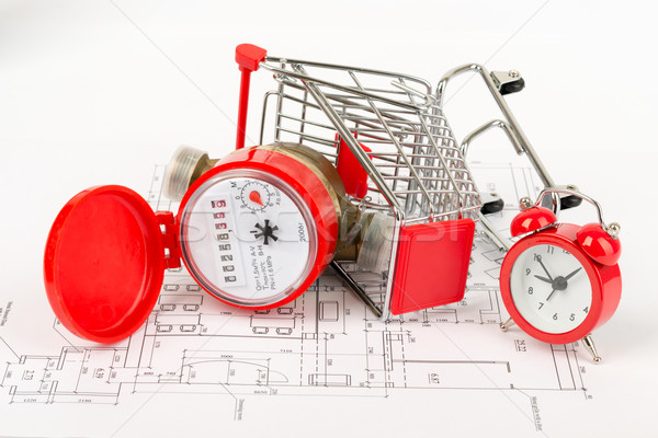 Water meter in shopping cart with alarm clock Stock photo © cherezoff