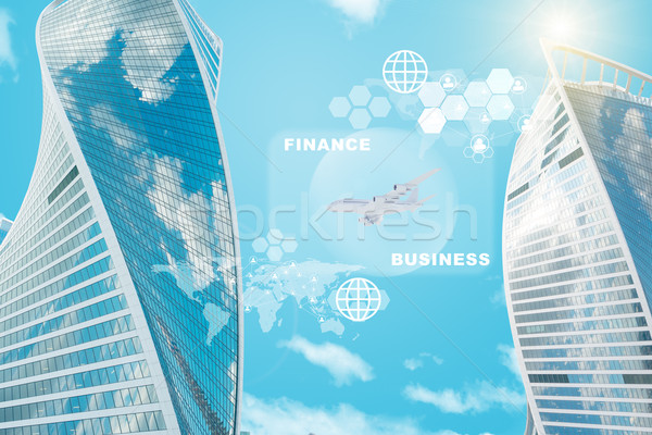 High building with computer icons Stock photo © cherezoff