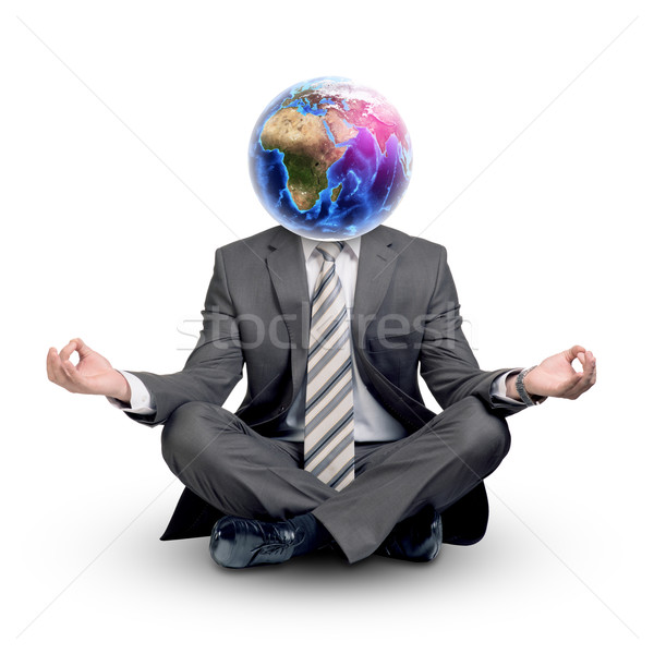 Man with Earth instead head in lotus posture Stock photo © cherezoff