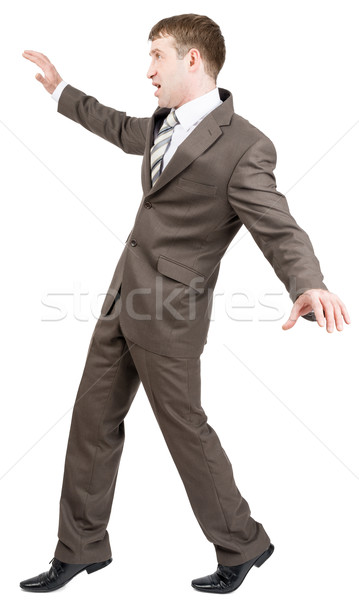 Businessman on tiptoes Stock photo © cherezoff