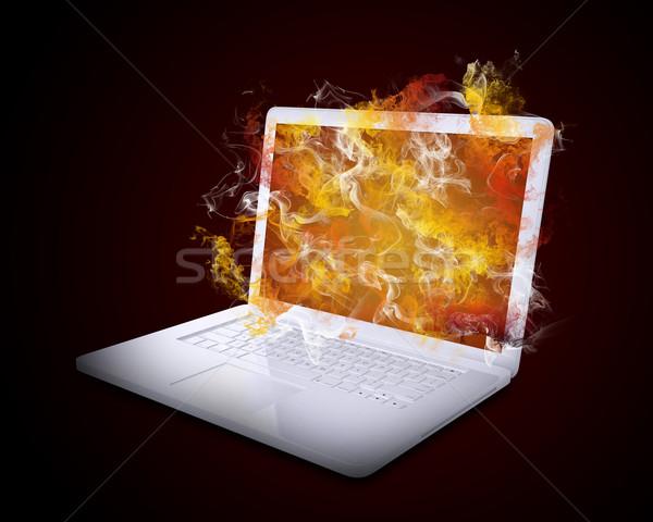 Stock photo: Open white laptop emits colored smoke