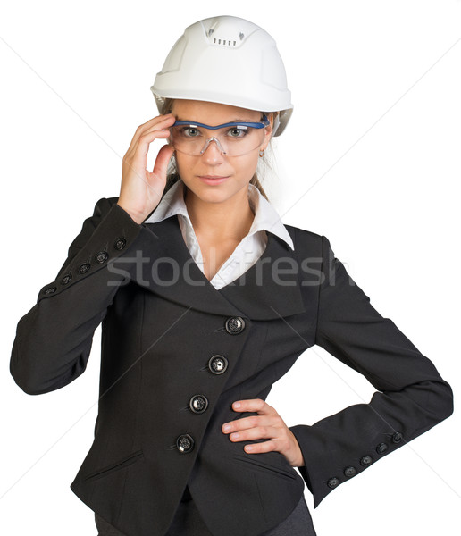 Businesswoman posing in hard hat and protective glasses Stock photo © cherezoff
