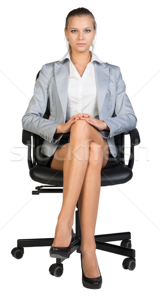 Businesswoman on office chair Stock photo © cherezoff