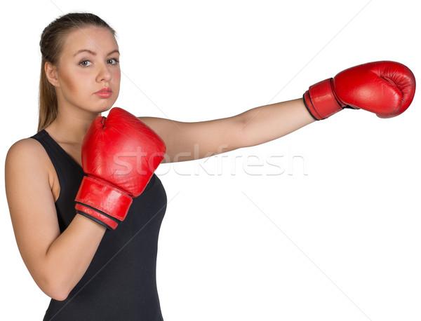 Woman wearing boxing gloves, in punching pose Stock photo © cherezoff
